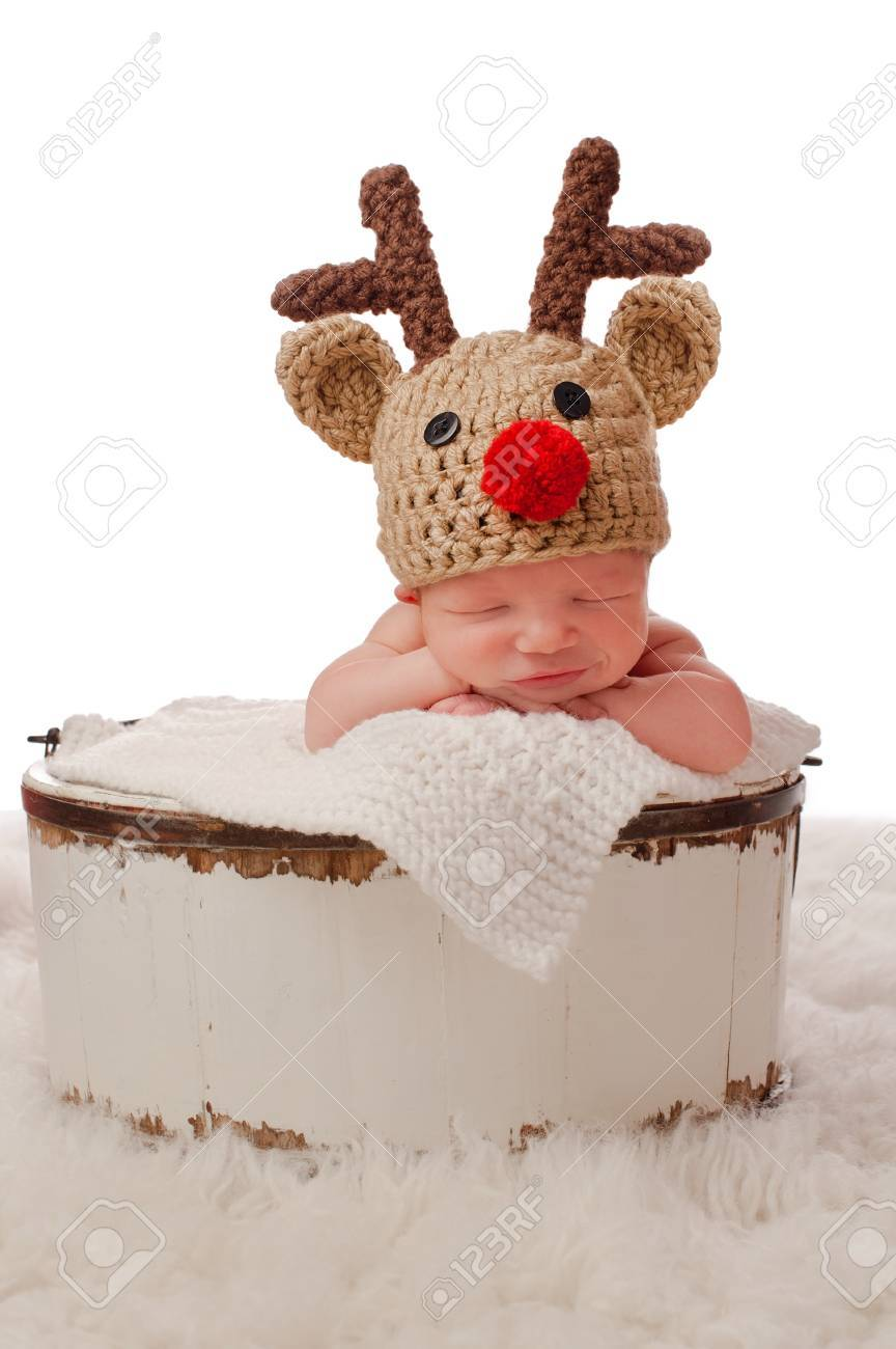 f225658c6a210 A smiling eight day old newborn baby boy wearing a red nosed..