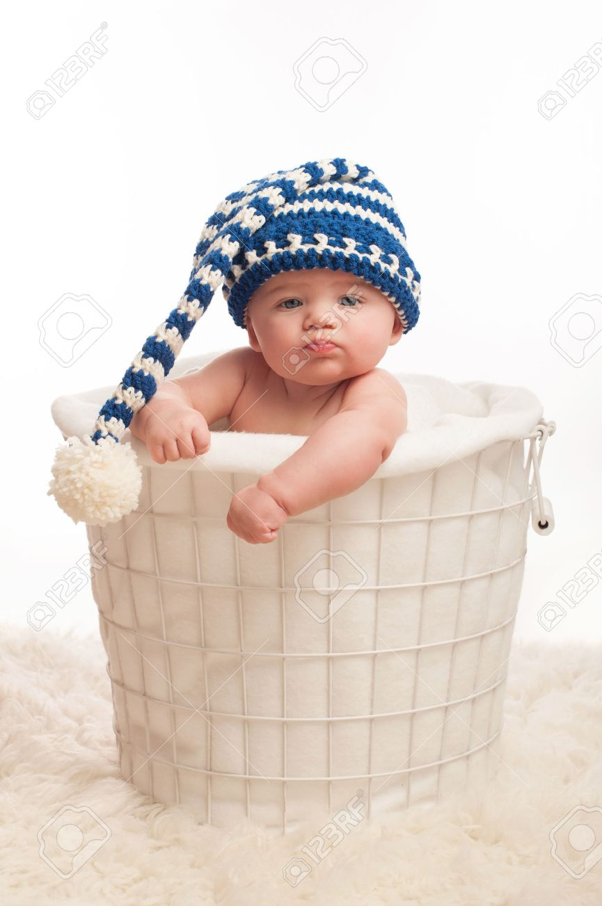 A 4 Month Old Baby Boy Wearing A Stocking Cap. He Is Sitting.. Stock ... fd3ebc5b0fd