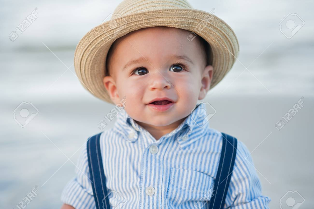 17779b4cb31 A Headshot Of A One Year Old Baby Boy Wearing A Straw Fedora.. Stock ...