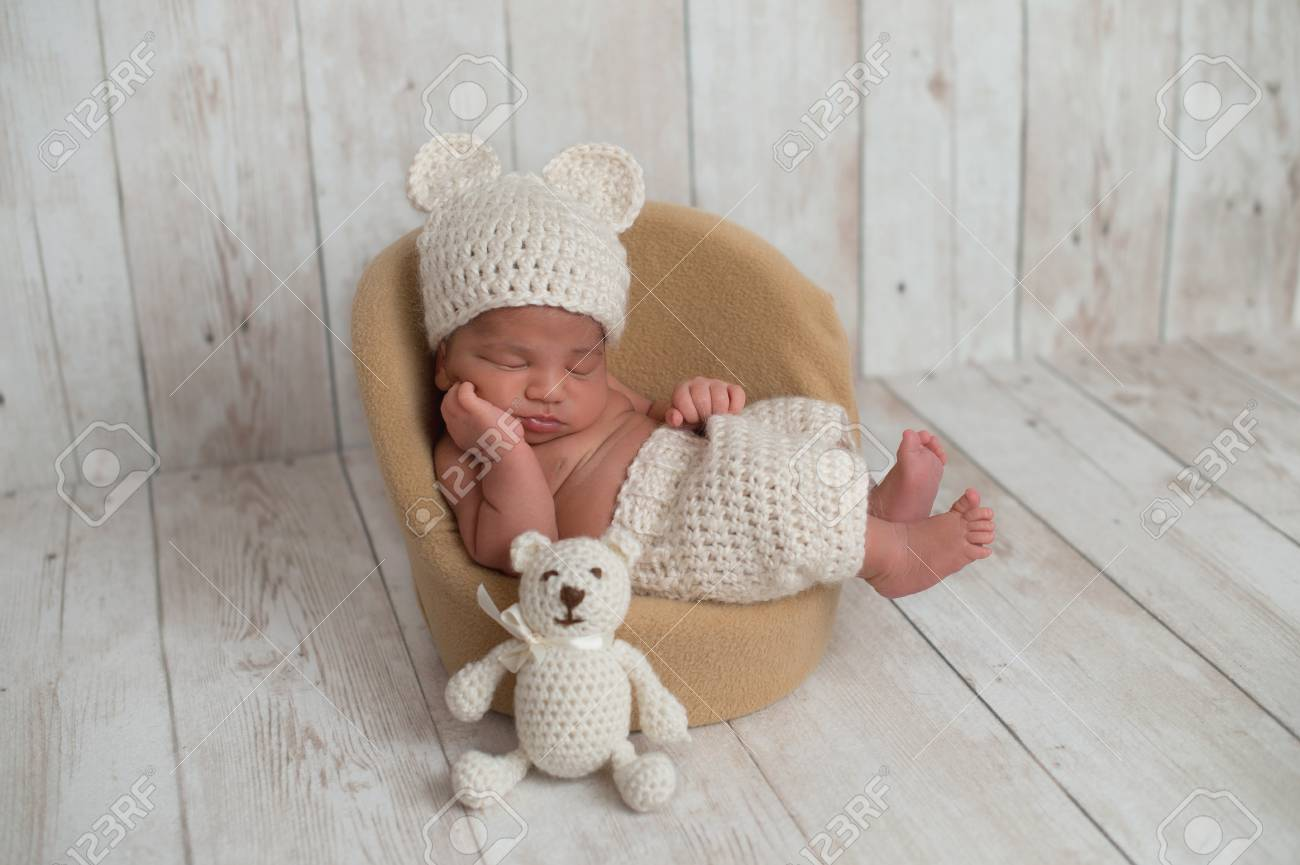 d04dcc58e79 Nine Day Old Newborn Baby Boy Wearing Cream Colored