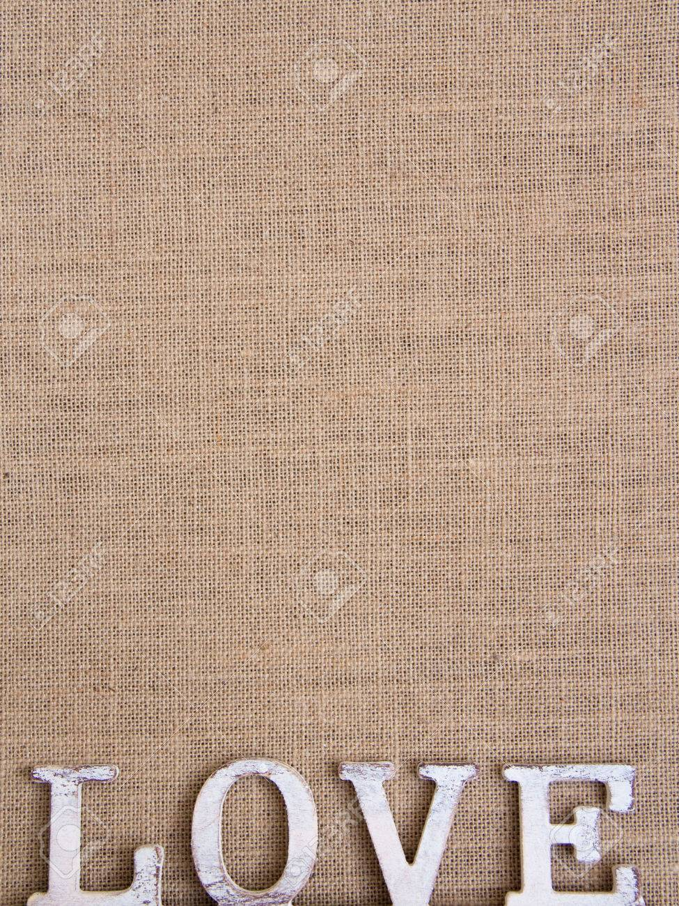 Word love on burlap Shabby chic Archivio Fotografico - 25707917