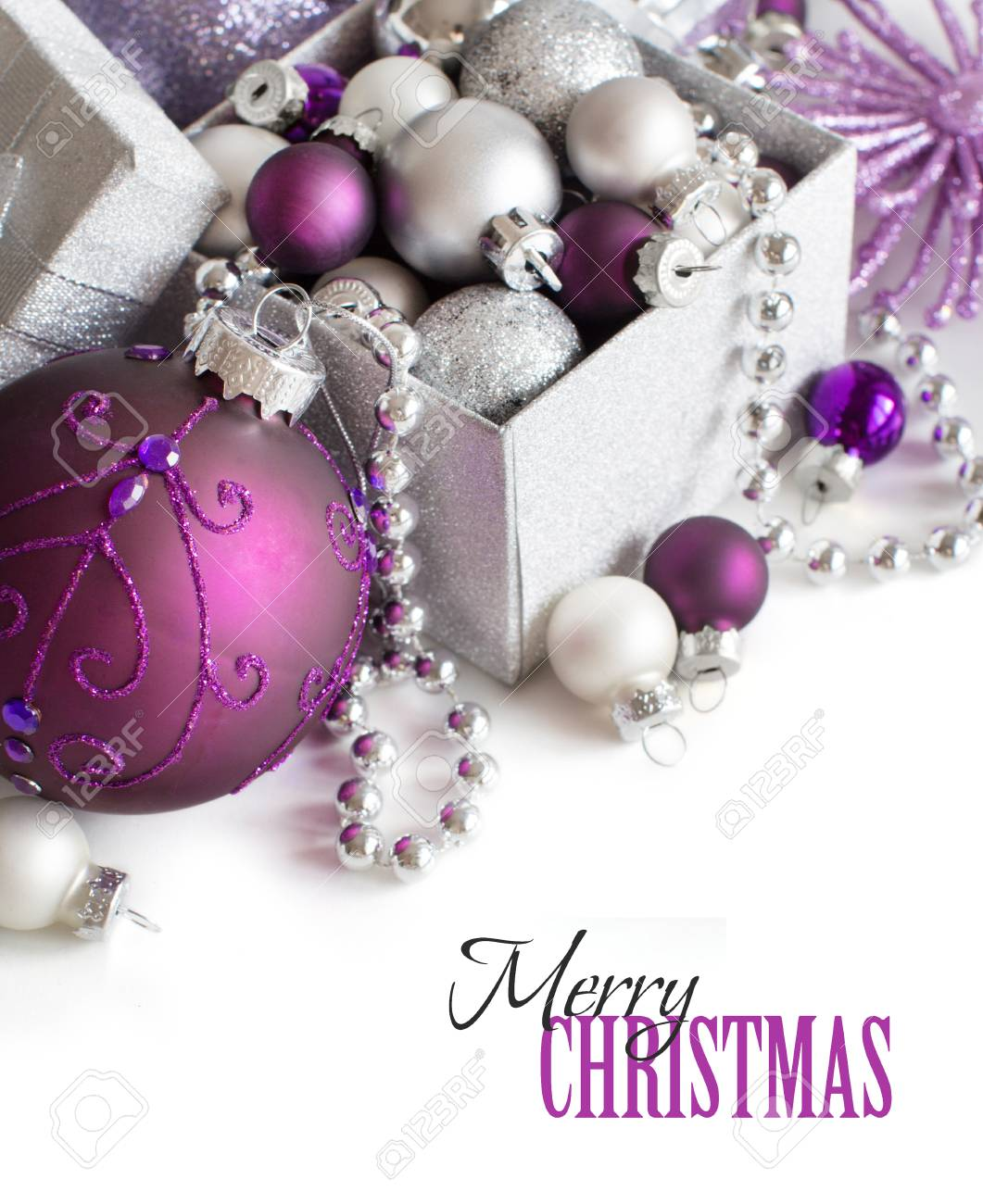silver and purple christmas ornaments border on white background stock photo 51360549