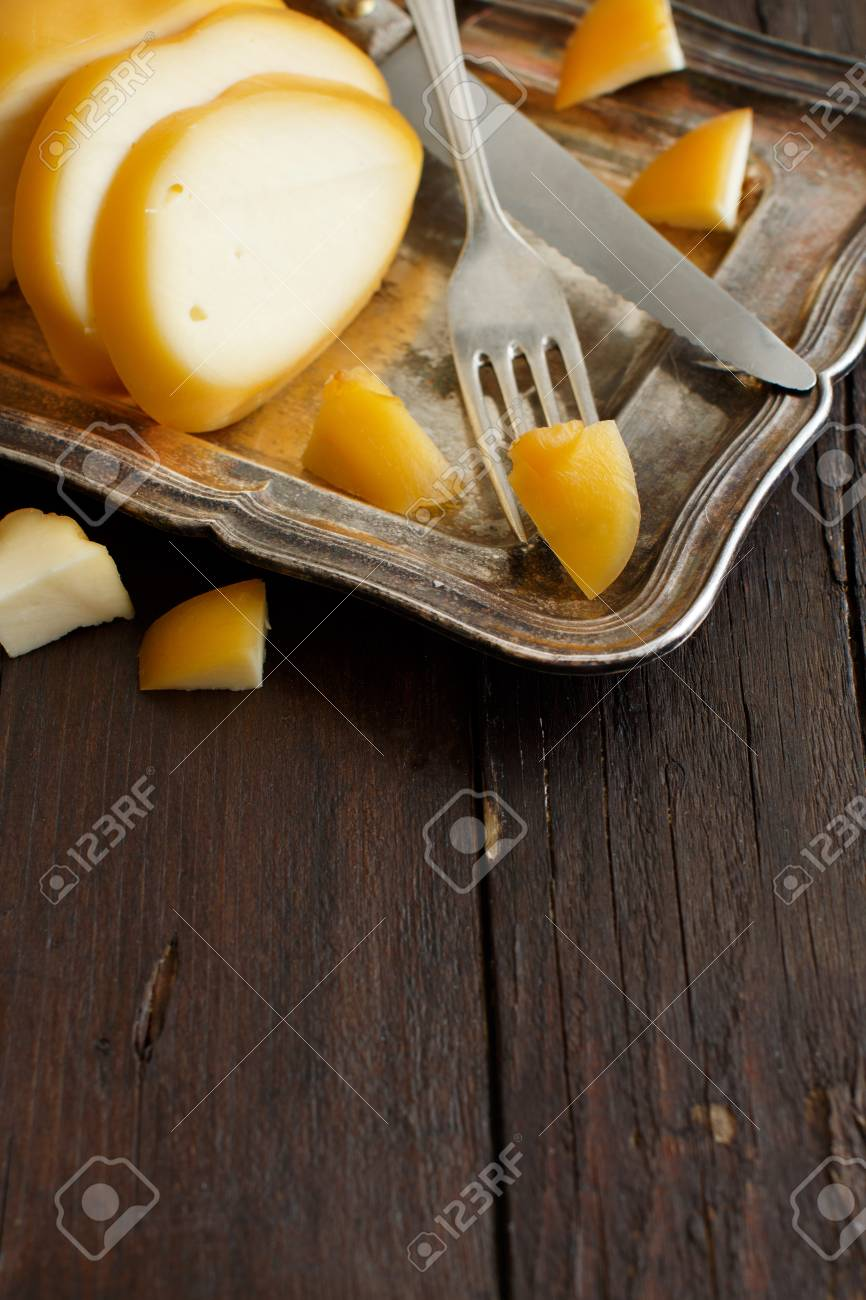 Scamorza, typical italian smoked cheese on wooden table Archivio Fotografico - 75271518