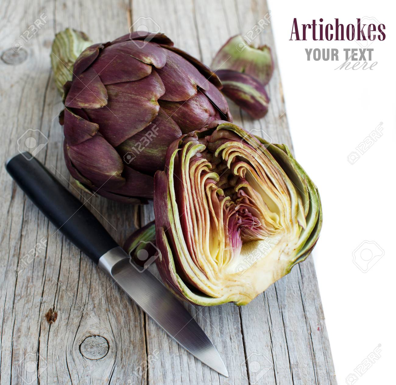 Roman Artichokes on a wooden board with knife Archivio Fotografico - 75336133