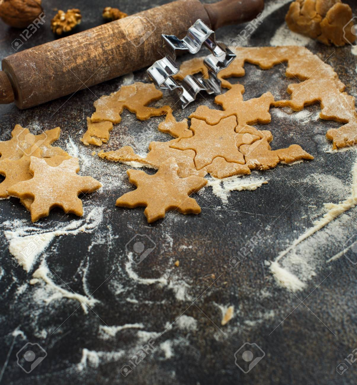Cooking Christmas Cookies With Snowflake Cookie Cutters On A