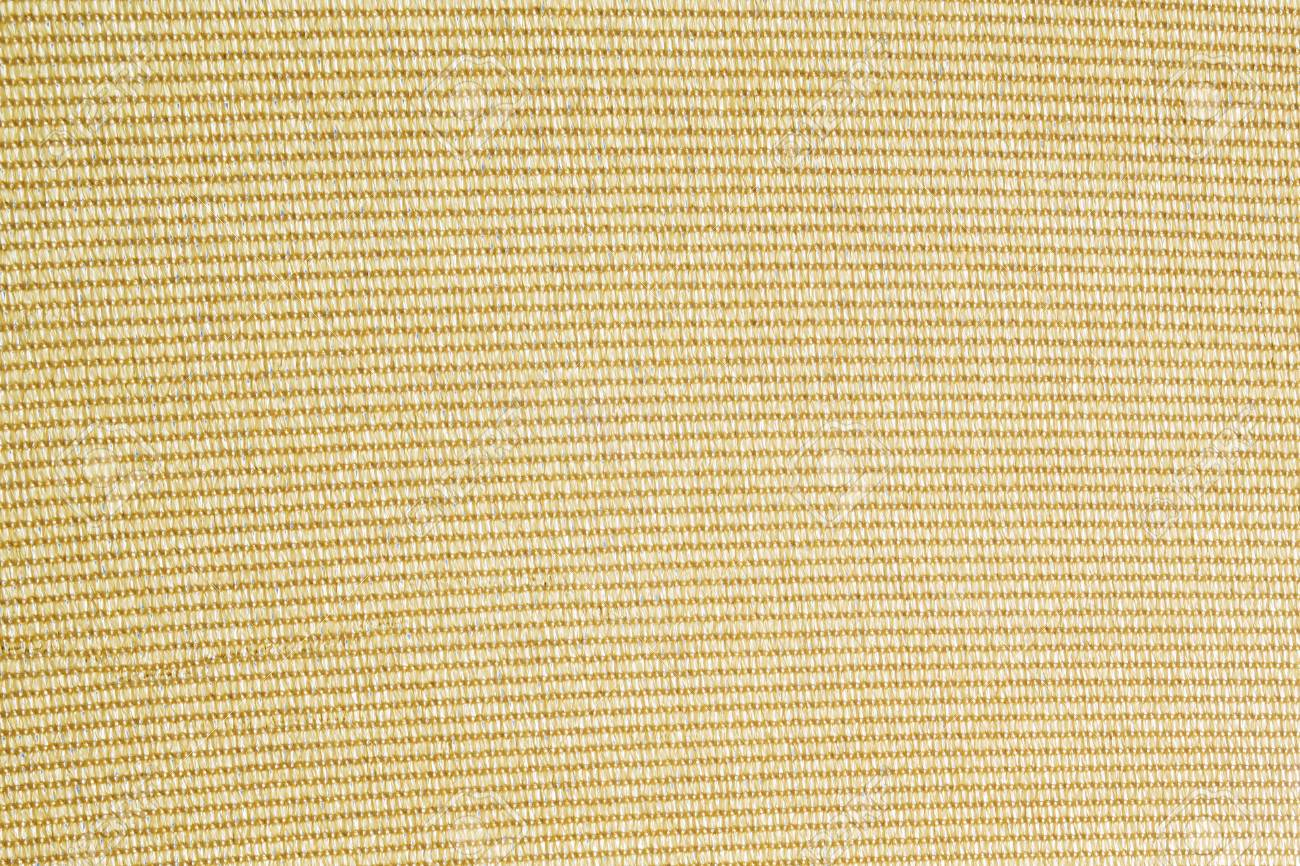 Yellow Structure Of A Knitted Cotton Fabric Background Stock Photo