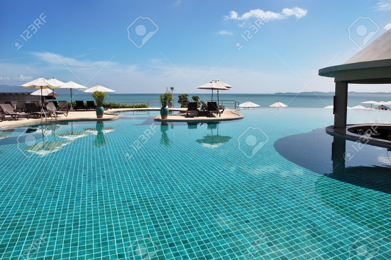 Tropical resort. Poolside with beautiful sea view Stock Photo - 11651724