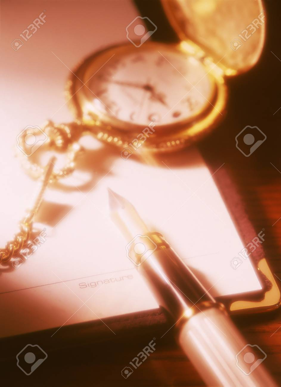 pocket watch and fountain pen Stock Photo - 21848303