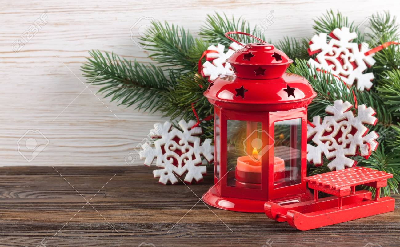 christmas and new year red candle lantern christmas tree and decorations on white wooden background