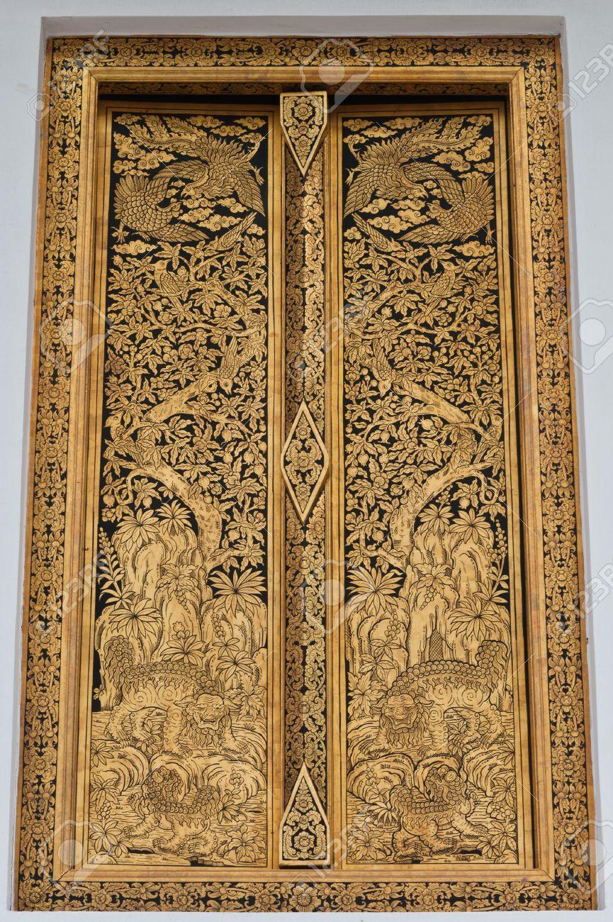 Golden Thai Design Craft On Wooden Door In Thai Temple Stock Photo