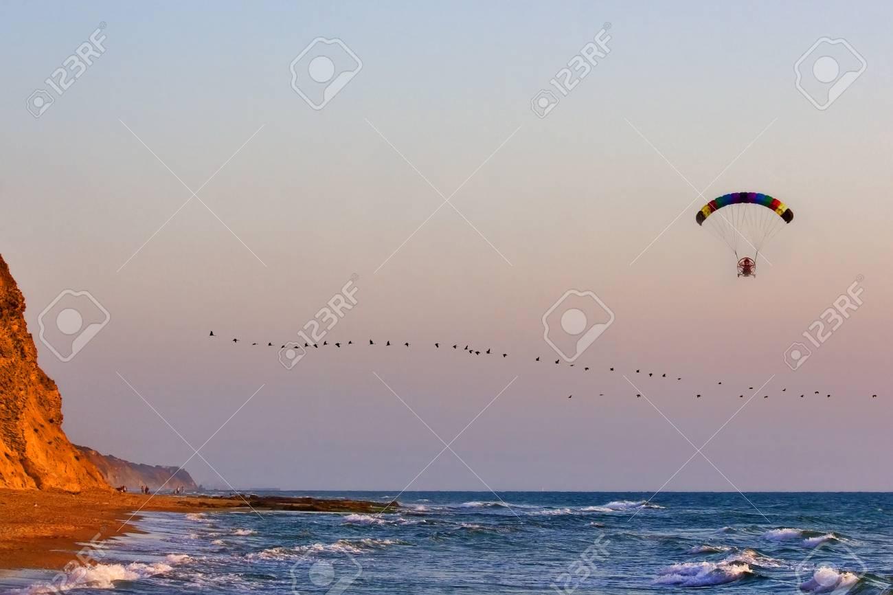 Flight on an operated parachute along coast of Mediterranean sea Stock Photo - 1446796