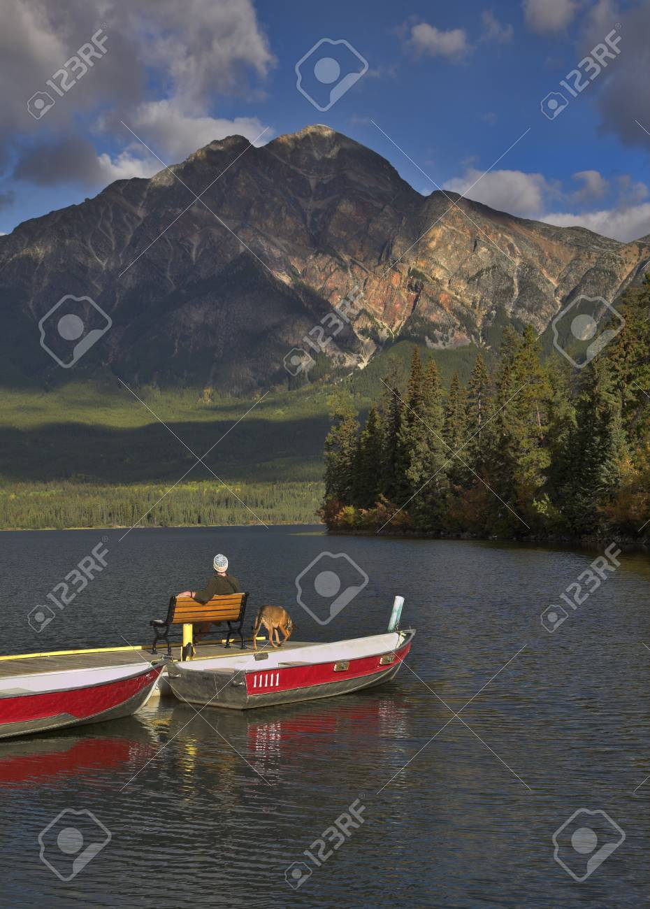 The tourist having a rest on a bench on a boat pier Stock Photo - 3925159