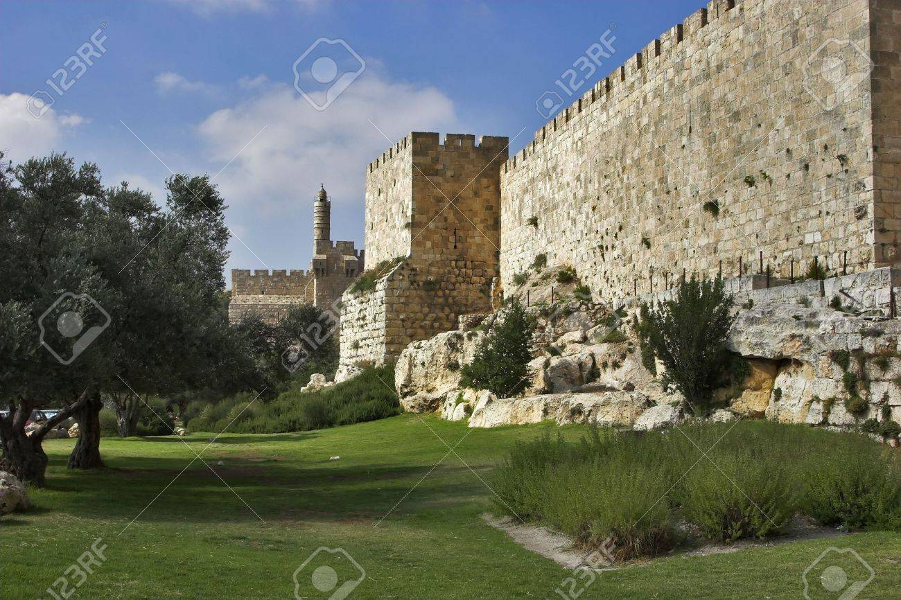 A green lawn and trees at a wall of Jerusalem near David's tower Stock Photo - 5009591