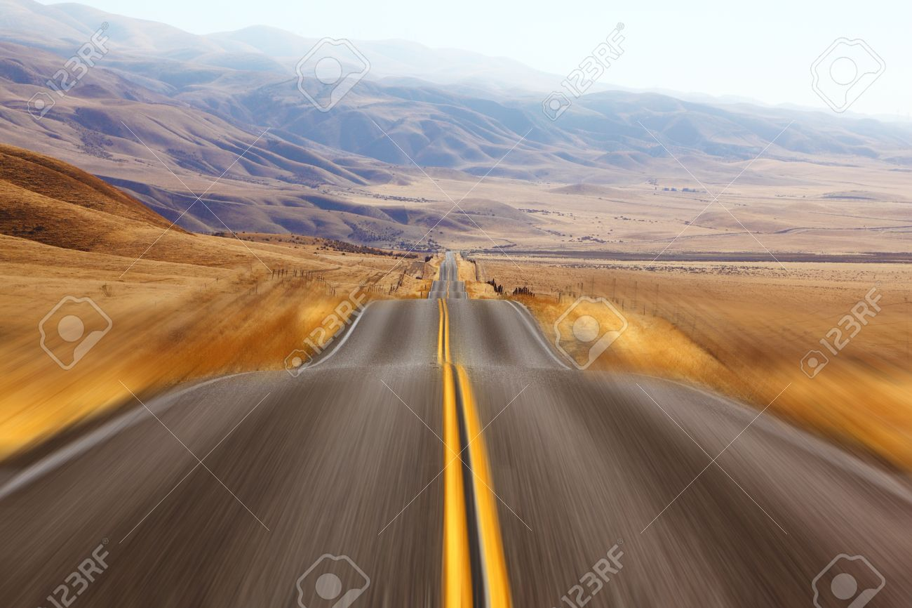 California, autumn day. Magnificent American road and fencings on roadsides from snow drifts Stock Photo - 8688369