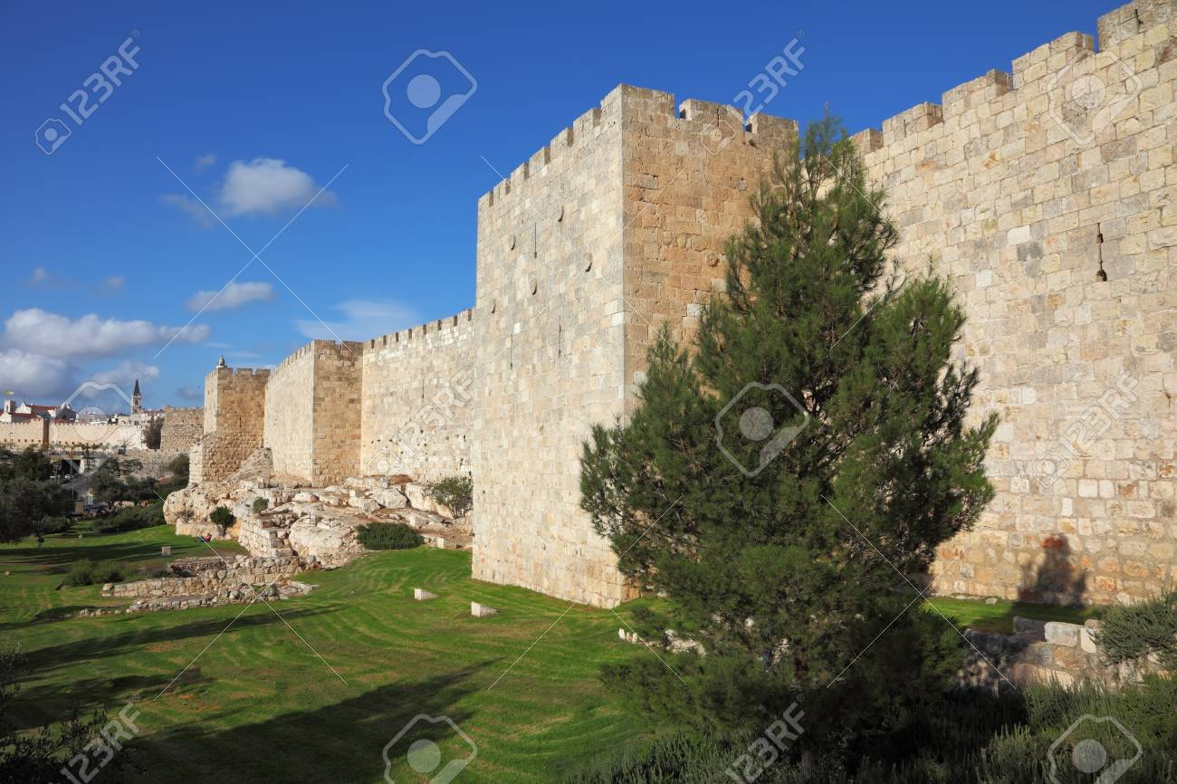 A lovely sunny day in Jerusalem  The walls and towers against the sky and clouds Stock Photo - 13117938