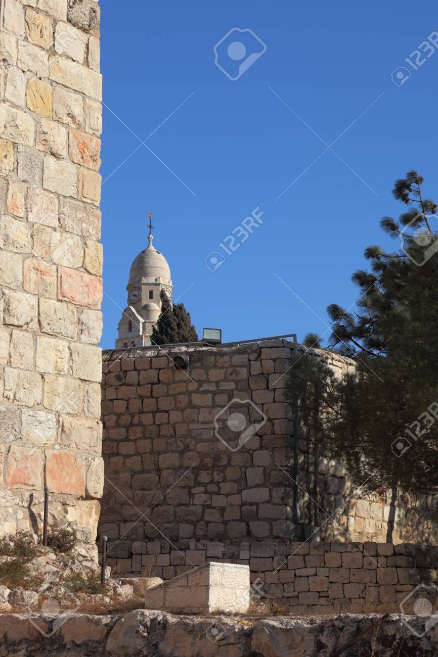 A lovely sunny day in Jerusalem. The walls and towers against the sky and clouds Stock Photo - 13409446