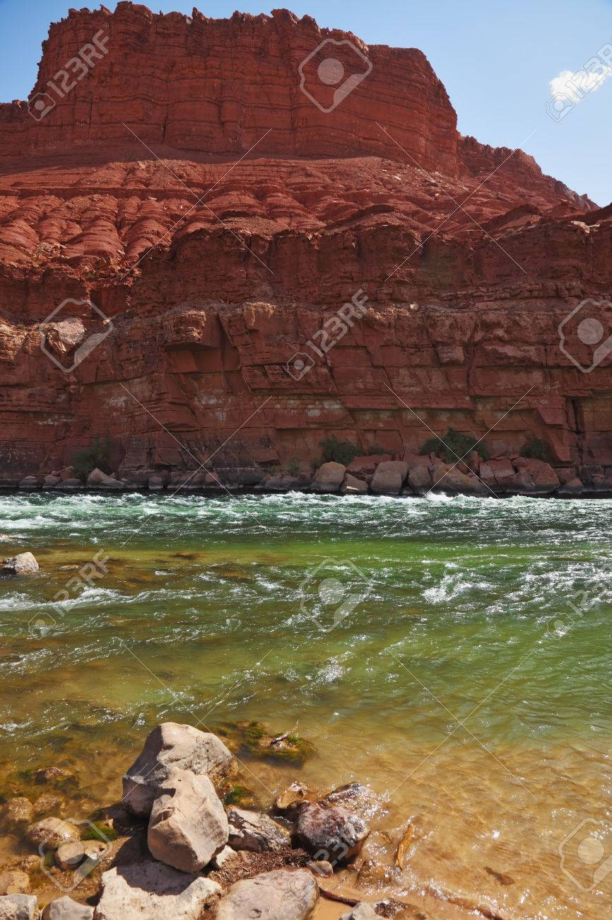 Cold green water of the Colorado River in the red rocks of the