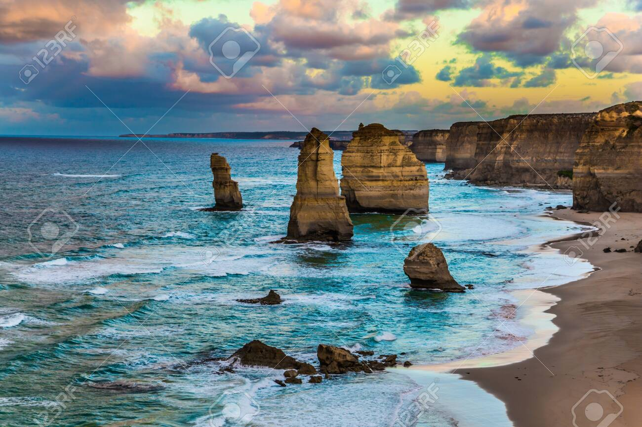 """Travel to Australia. Early morning on the ocean shore. Pink dawn clouds over the famous rocks """"Twelve Apostles"""". The concept of active, ecological and photo tourism - 123022228"""