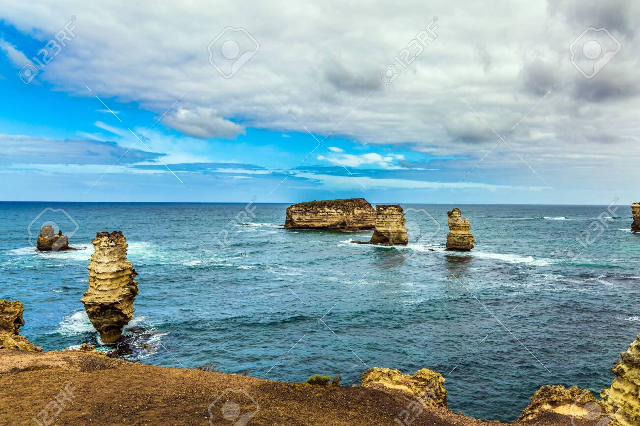 The Great Ocean Road of Australia. Coastal islands - rocks in small bay. The Pacific ocean. The concept of exotic, active and photo-tourism - 123837855