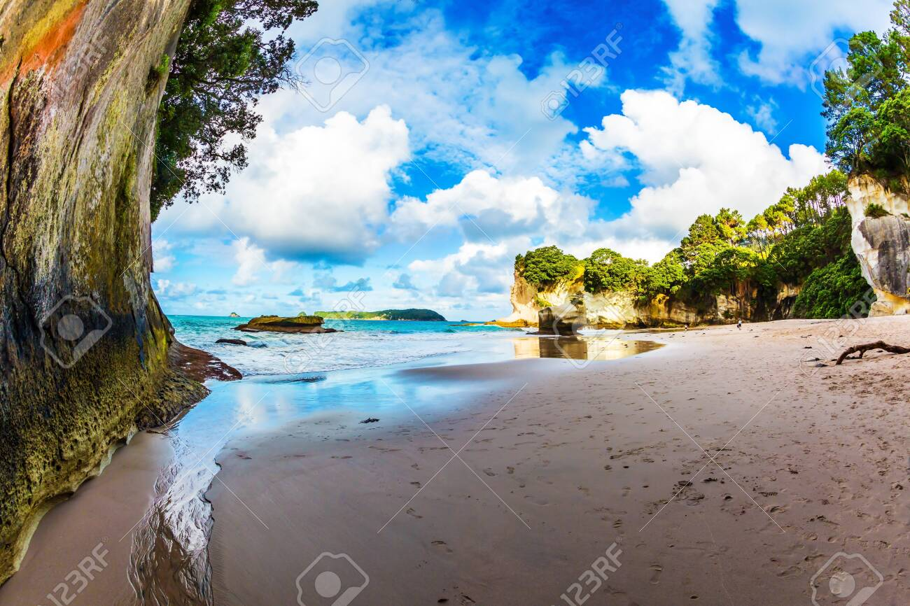 Coast of the North Island of New Zealand. The Cathedral Cave. Stunning sunset on the beach. Concept of active and ecological tourism - 123889189