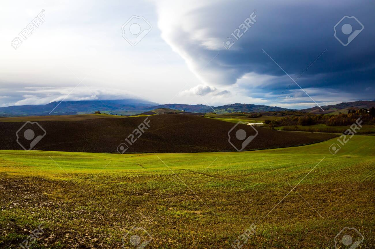 Picturesque and legendary Tuscany. Storm begins over Tuscany hills. Beautiful Italy. The concept of active, rural and photo tourism - 148072807