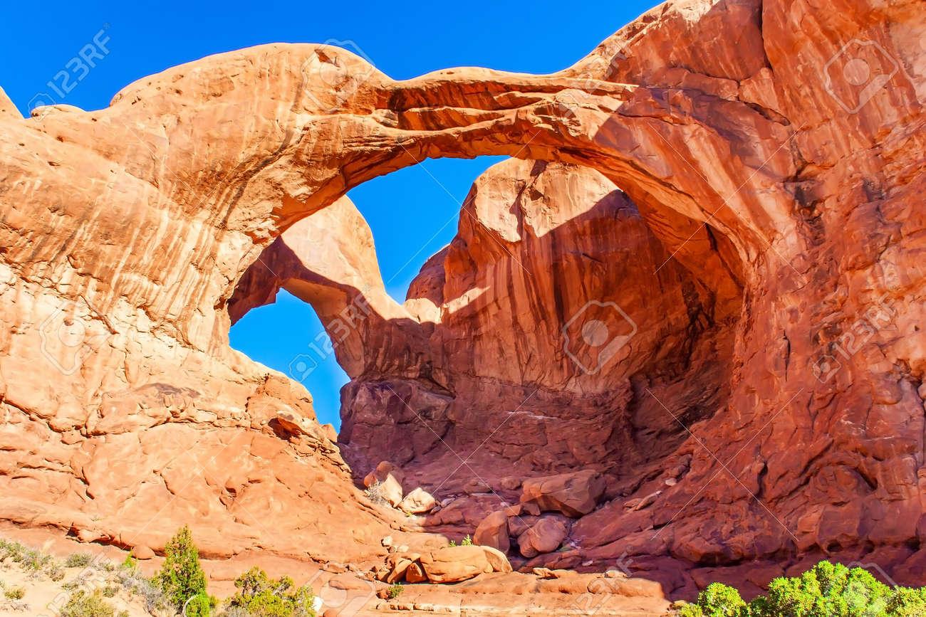 Double Arch. The beauty of Arches Park in USA. Picturesque red-brown sandstone cliffs form a unique landscape. Grandiose rock compositions natural origin. - 165739521