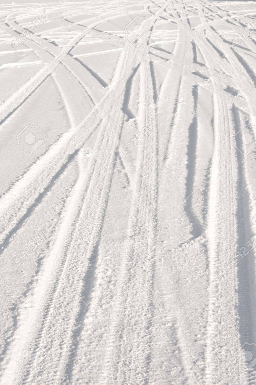 Snowy road with tire tracks going in several directions. Nice winter background. Stock Photo - 6701313
