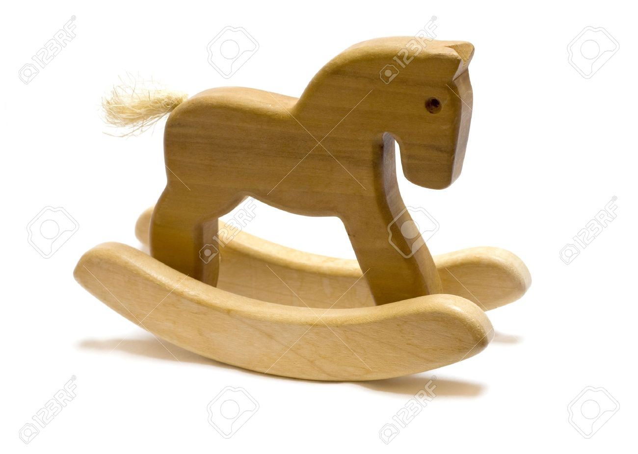 Classic homemade wooden rocking horse on white background. Stock Photo - 8189763