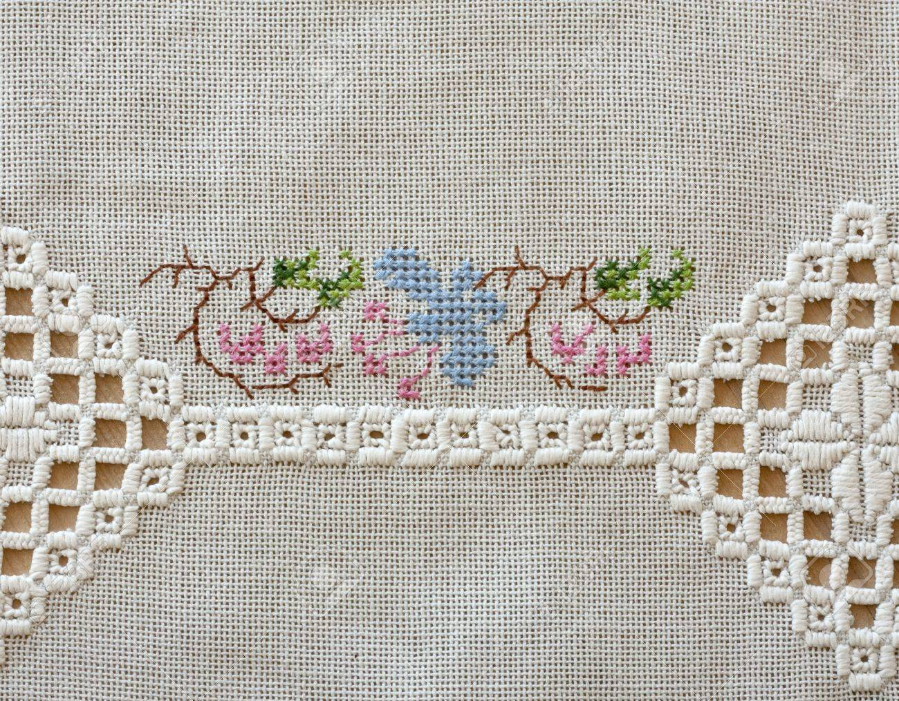 Embroidered Cloth On Wooden Table With Two Different Types Of