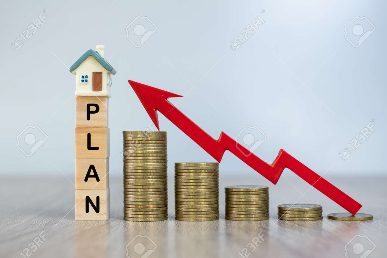 """Red arrow on a pile of coins A house on a wooden block written """"Planning"""". The concept of real estate growth, planning for future housing - 151605499"""