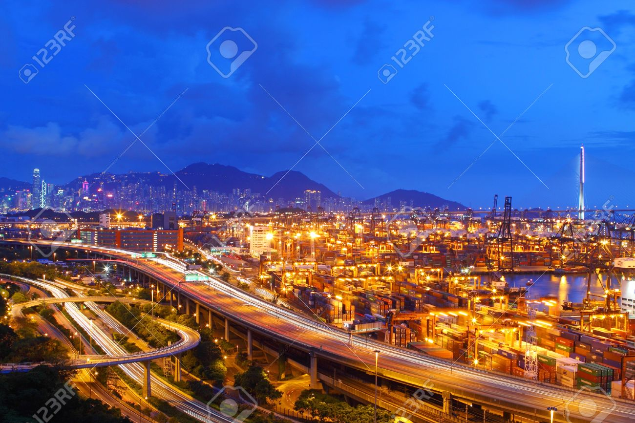 Busy traffic in Hong Kong at night with container terminal background Stock Photo - 11829032