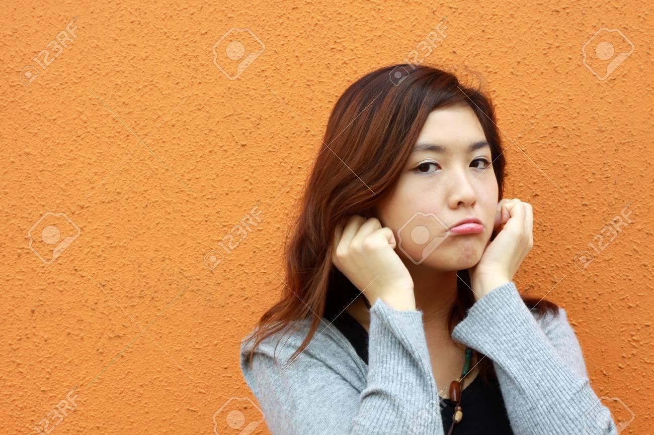 Asian woman doing something wrong Stock Photo - 13220510