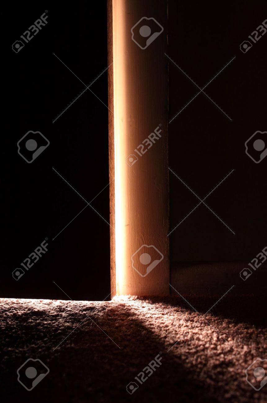 Light showing through slightly open door Stock Photo - 8856315