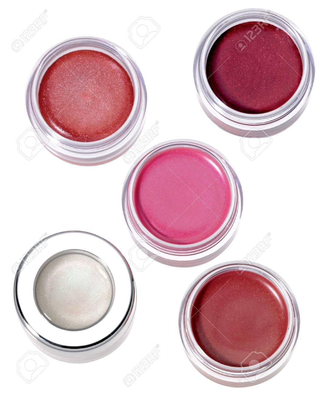 Multy-colored lip gloss in round silver plastic containers on white background