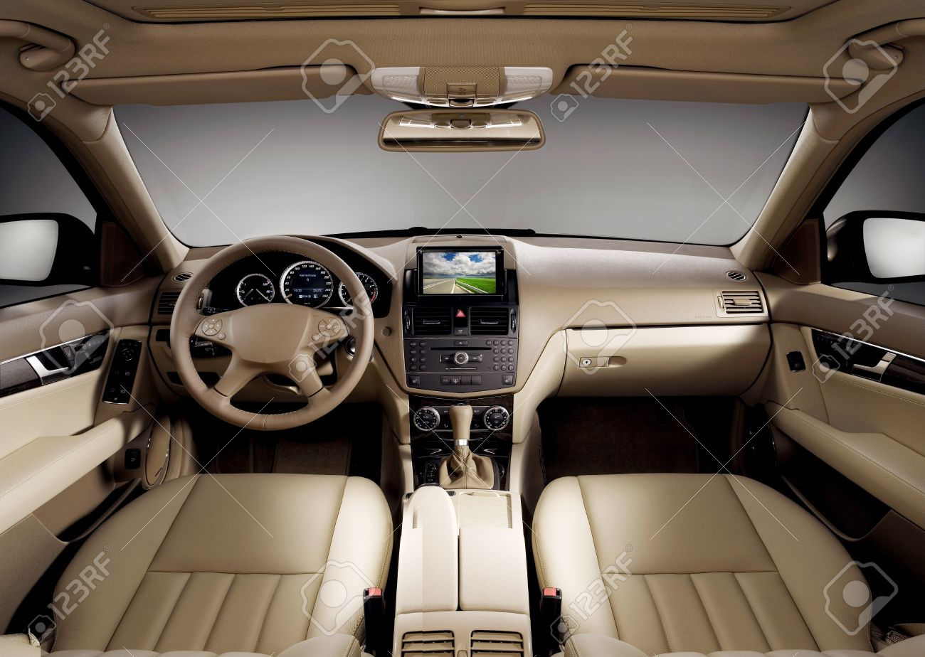 view of the interior of a modern business car showing the dashboard