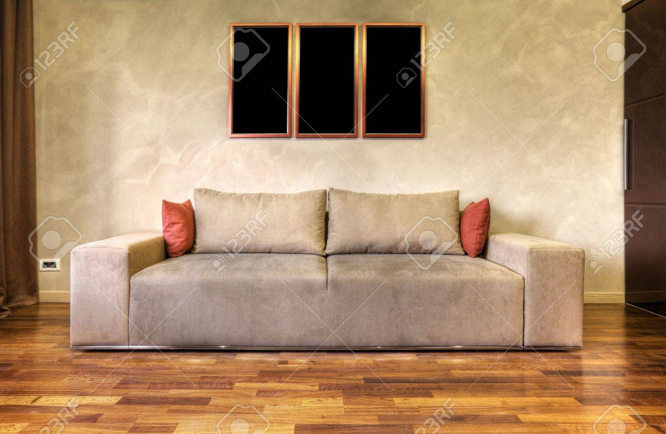 modern sofa in a white living room-rendering- the art pictures on wall are my composition Stock Photo - 9204025