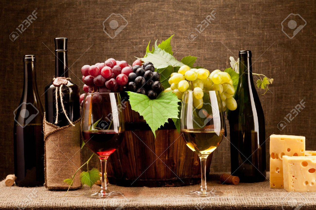 Still life with wine bottles, glasses and grapes Stock Photo - 11105480