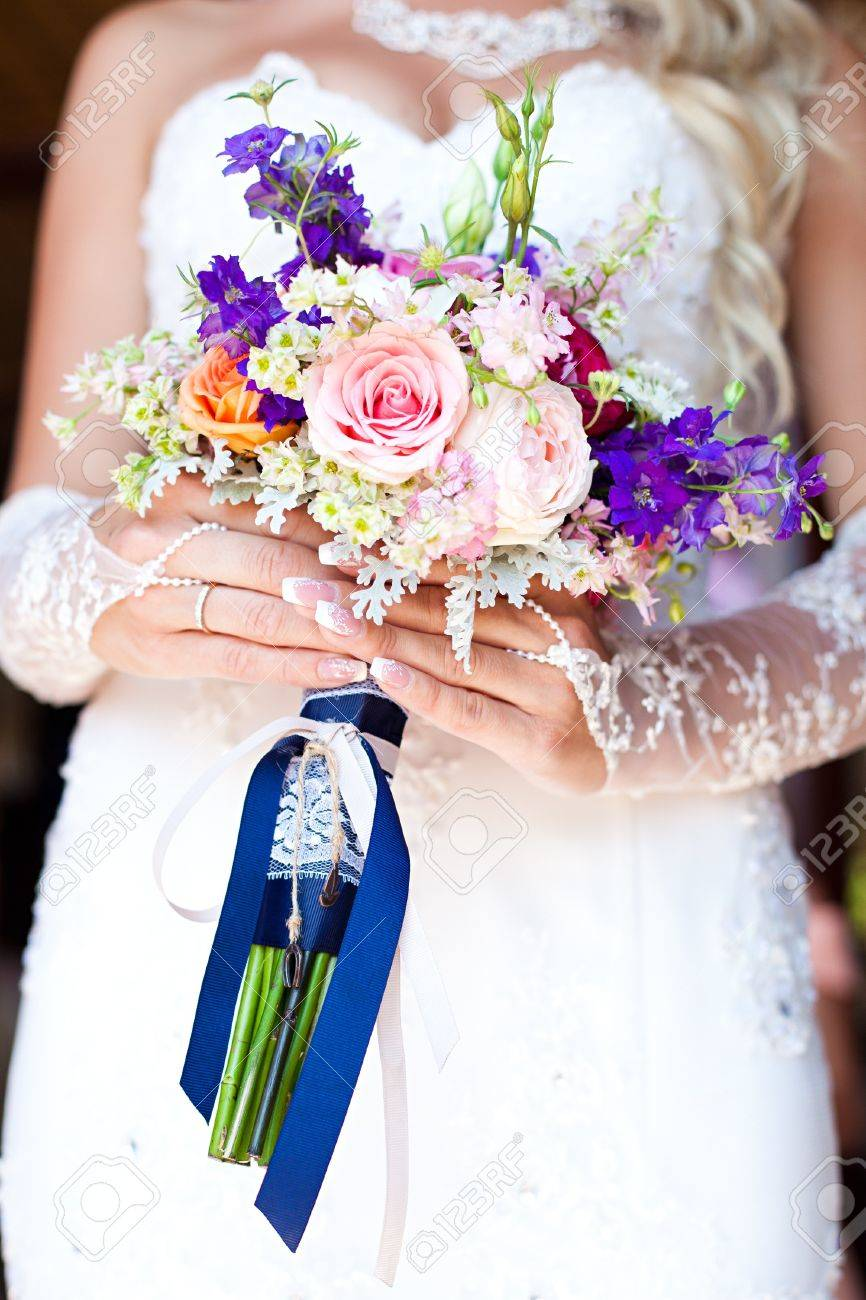 Bride Holding Beautiful Wedding Bouquet Of Purple And White Flowers