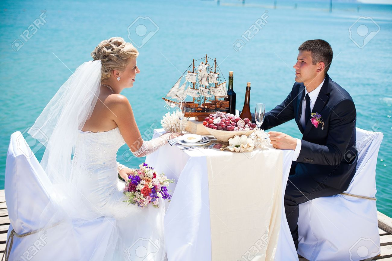 Bride Groom Table Decoration Beautiful Couple In Love The Bride And Groom Posing On The Bridge