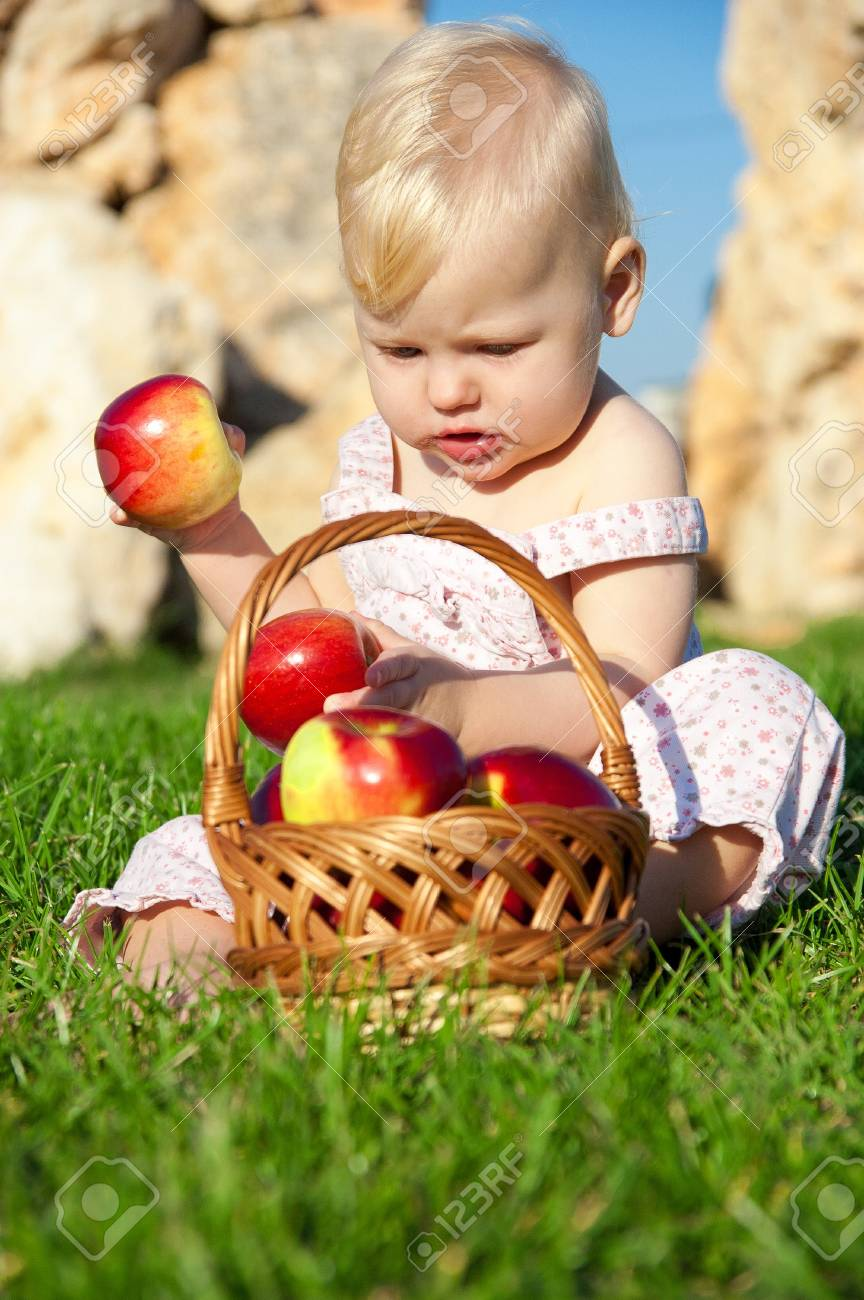 The child, a basket of apples Stock Photo - 16583113