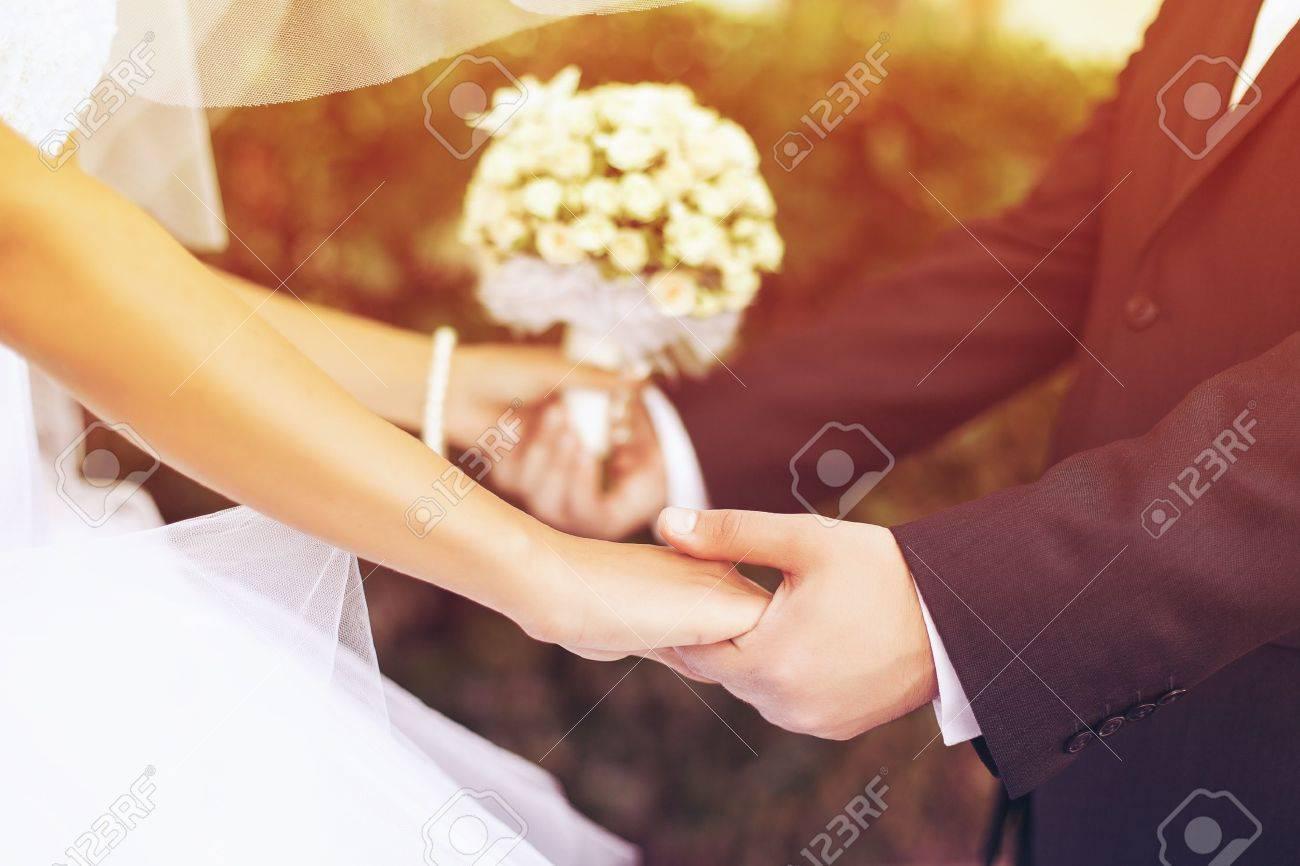 Wedding couple holding hands - 17007252