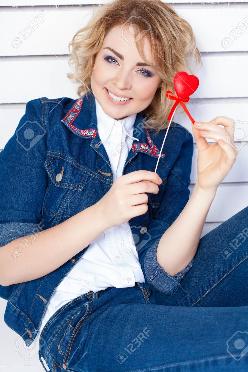 Young woman in blue denim holding heart Stock Photo - 17229258