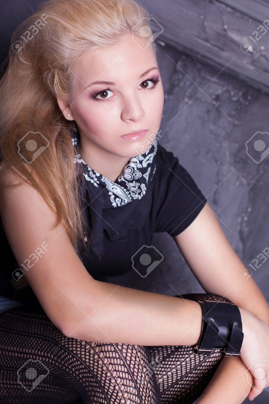 teen punk girl against wall background Stock Photo - 17229238