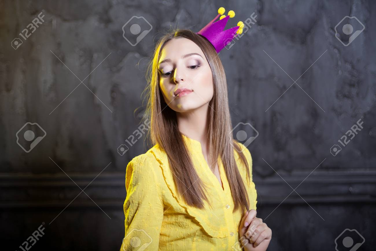 Young majestic woman in crown. Portrait of queen in studio. Stock Photo - 17229254