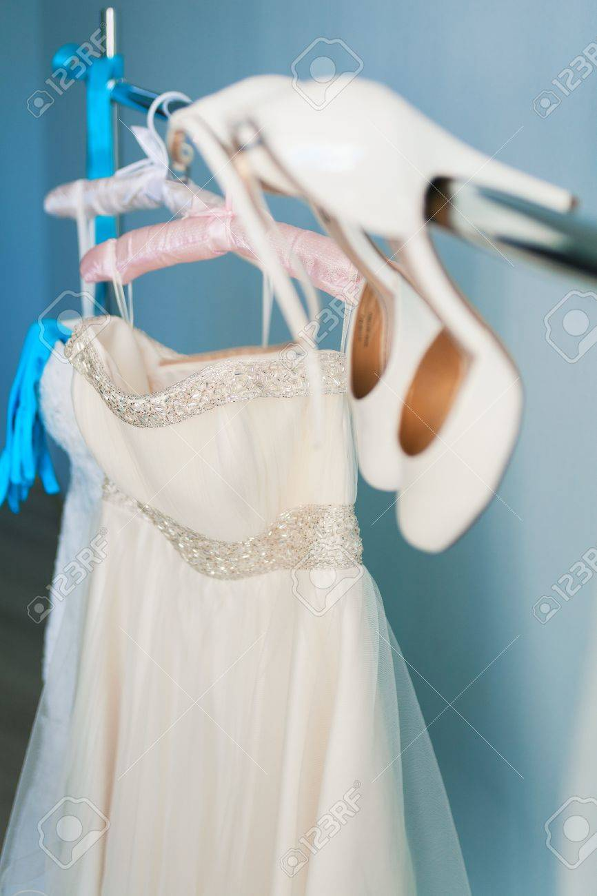 Wedding Dress And Accessories On Hanger Stock Photo, Picture And ...