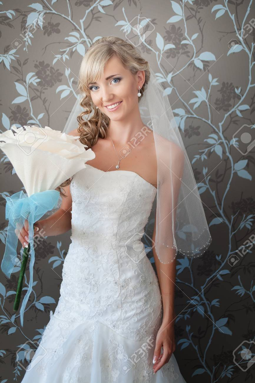 Beautiful blond bride portrait in white dress Stock Photo - 17416190