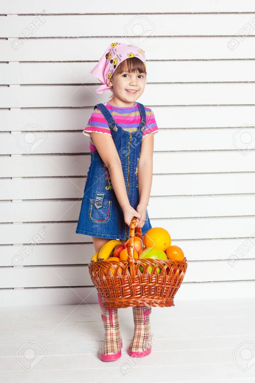 girl with basket of fruits over wall background Stock Photo - 17416195