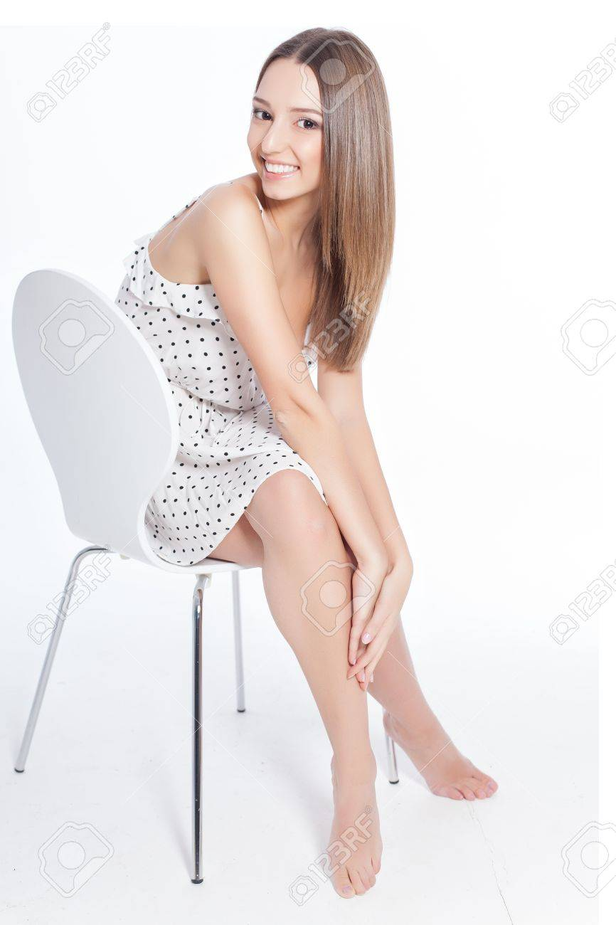 healthy woman with attractive perfect legs over white background Stock Photo - 17416218
