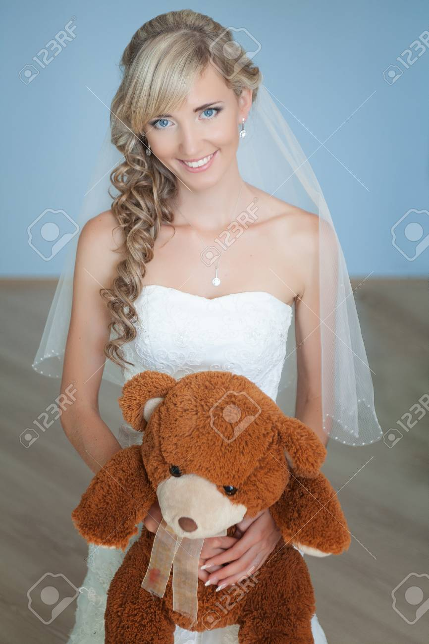 wedding  portrait of bride with a toy bear Stock Photo - 17479269