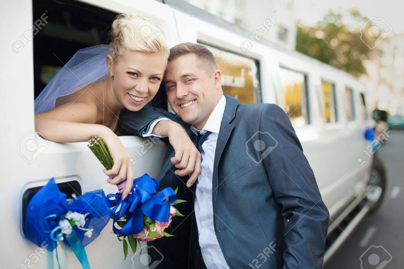 couple in love bride and groom posing at car window - 17564019